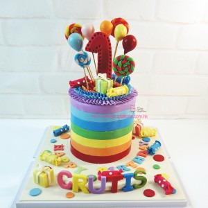 Colorful rainbow themed 1st birthday cake