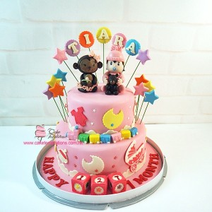 2 Layers baby girl & baby Monkey Celebration cake
