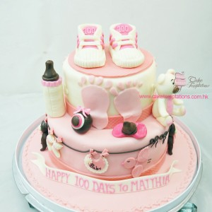 2 layers Pink baby shoes 100 days cake